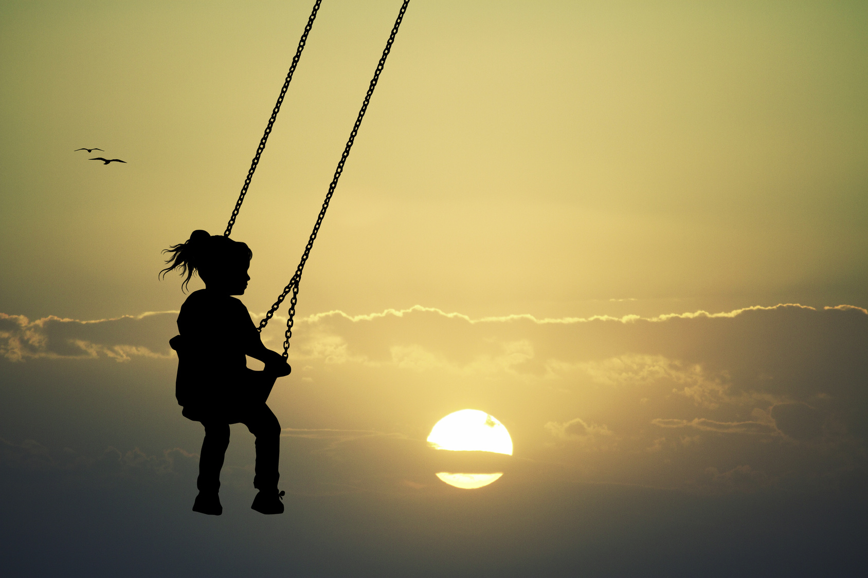 Inner Child- Girl on swing at sunset